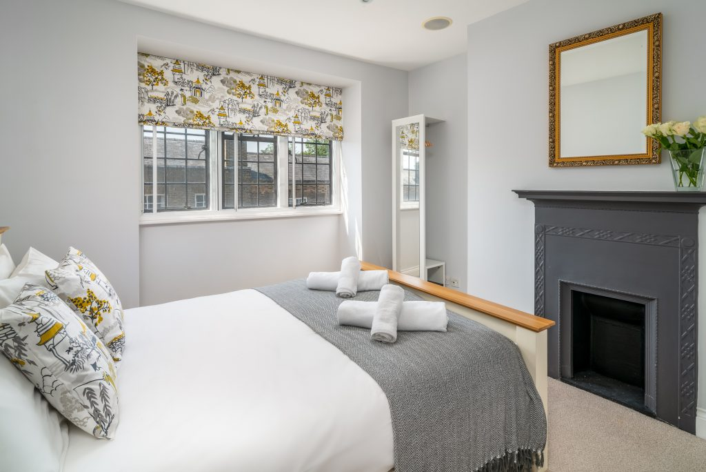 A well presented bedroom in a serviced apartment
