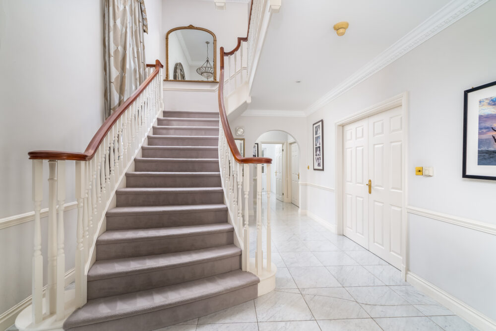 Sweeping stairway and hallway in high end Buckinghamshire property
