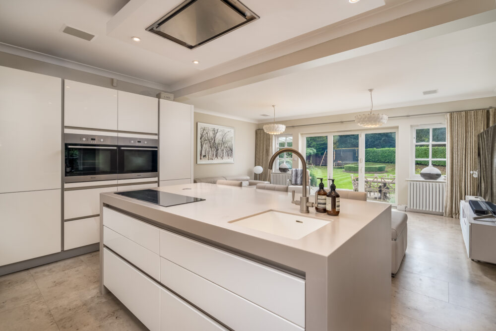 Prime South Bucks property kitchen showing large open plan kitchen and living space with views of the garden