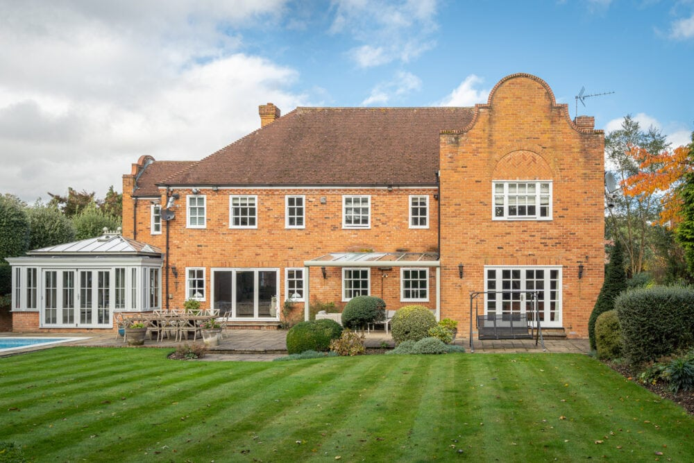 Premium property exterior in Beaconsfield showing garden and swimming pool